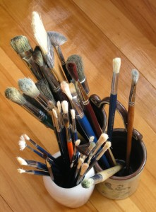 Artist paint brushes in containers