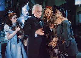 Dorothy, Tin Man, Cowardly Lion and Scarecrow with the Wizard